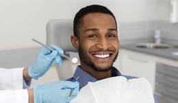 A young man preparing to have his teeth checked and cleaned during an appointment