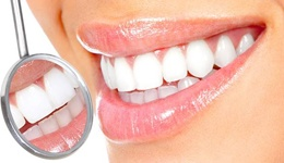 Close-up of beautiful smile with dental mirror