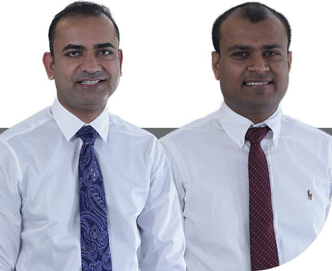 Denton dentists Dr. Ahir and Dr. Shekhadiya