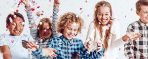 children smiling confetti