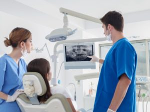 dentist pointing to a dental x-ray