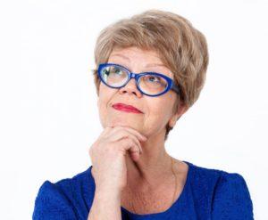 woman deciding on veneers or crowns