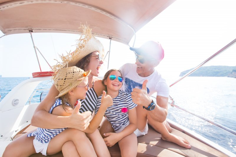 family on yacht during summer vacation